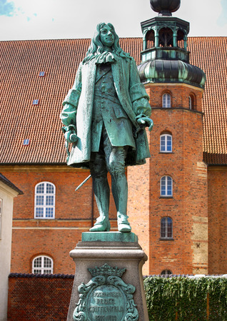 chancellor: The statue of Chancellor Peder Griffenfeld and a tower in Copenhagen, Denmark