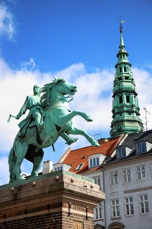 Hojbro Plads Square with the equestrian statue of Bishop Absalon and St Kunsthallen Nikolaj church in Copenhagen, Denmark Editorial