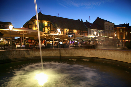 lilla: MALMO, SWEDEN - AUGUST 16, 2016: View of beautiful night scene and fountain on the market place Lilla Torg in Malmo, Sweden on August 16, 2016. Editorial