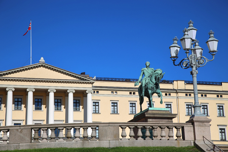 The Royal Palace and statue of King Karl Johan XIV in Oslo, Norway Editorial