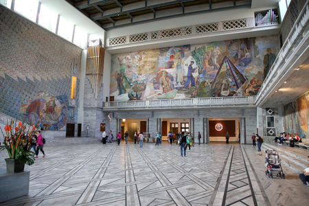 cityhall: OSLO, NORWAY – AUGUST 18, 2016: Tourists visit in interior of the Oslo City Hall in Oslo, Norway on August 18,2016.