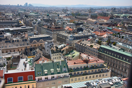 old center: Vienna, Austria - August 19, 2012: Panorama of Vienna, aerial view from Stephansdom cathedral, Peoples on streets, urban life in Vienna, Austria on August 19, 2012.
