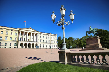 OSLO, NORWAY – AUGUST 17, 2016: Tourist visit The Royal Palace and statue of King Karl Johan XIV, Oslo is the capital city of Norway in Oslo, Norway on August 17,2016.
