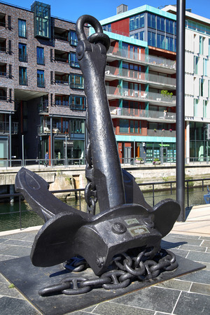 sunk: OSLO, NORWAY – AUGUST 17, 2016: Anchor on modern district on street Stranden, Bluchers Anker at Aker Brygge which was sunk in Oslofjord in 1940. in Oslo, Norway on August 17,2016.