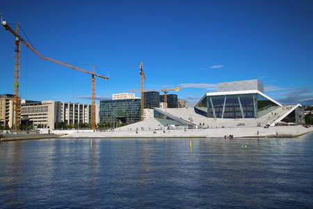 oslo: OSLO, NORWAY � AUGUST 17, 2016: Tourist on the Oslo Opera House which is home of Norwegian National Opera and Ballet and National Opera Theatre in Oslo, Norway on August 17,2016.