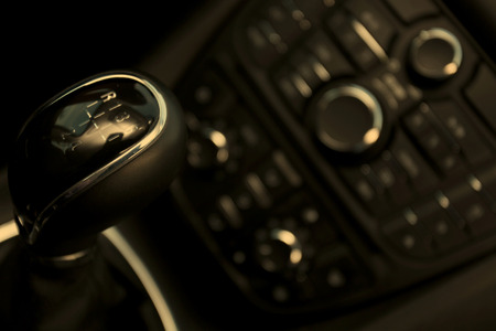 Details closeup of cockpit and dash, gearstick in modern car