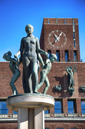 cityhall: Family Group bronze sculpture and Oslo City Hall (Radhus) in Oslo, Norway