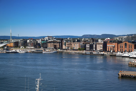 View on modern district Stranden, Aker Brygge district with lux apartments  and restaurants in Oslo, Norway  Stock Photo