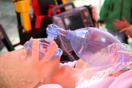 compressions: Details of practicing to use an oxygen mask on training doll