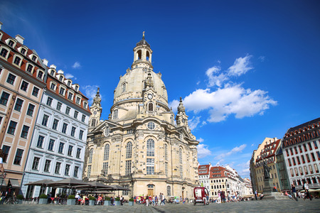 DRESDEN, GERMANY  AUGUST 13, 2016: People walk on Neumarkt Square at Frauenkirche (Our Lady church) in the center of Old town in Dresden, State of Saxony, Germany on August 13, 2016.