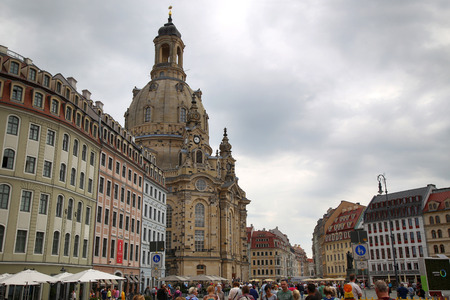 dresden: DRESDEN, GERMANY – AUGUST 13, 2016: People walk on Neumarkt Square at Frauenkirche (Our Lady church) in the center of Old town in Dresden, State of Saxony, Germany on August 13, 2016. Editorial