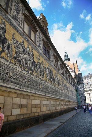 DRESDEN, GERMANY – AUGUST 13, 2016: Georgentor with historic buildings Furstenzug, Augustusstrasse in the center, in Dresden, State of Saxony, Germany on August 13, 2016. Editorial