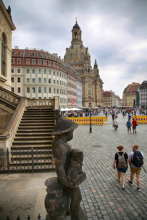 DRESDEN, GERMANY – AUGUST 13, 2016: People walk on Neumarkt Square at Frauenkirche (Our Lady church) in the center of Old town in Dresden, State of Saxony, Germany on August 13, 2016.