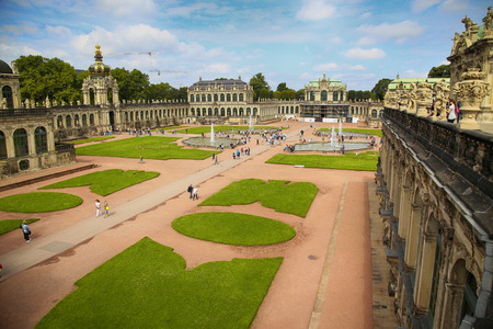 rebuilt: DRESDEN, GERMANY – AUGUST 13, 2016: Tourists walk and visit Dresdner Zwinger, rebuilt after the second world war, the palace is now the most visited monument  in Dresden, Germany on August 13, 2016.
