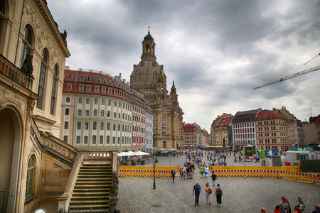 DRESDEN, GERMANY – AUGUST 13, 2016: People walk on Neumarkt Square at Frauenkirche (Our Lady church) in the center of Old town in Dresden, State of Saxony, Germany on August 13, 2016. Editorial