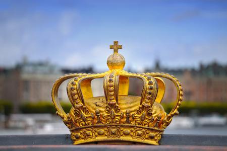 Skeppsholmsbron (Skeppsholm Bridge) with Golden Crown on a bridge in Stockholm, Sweden Stock Photo