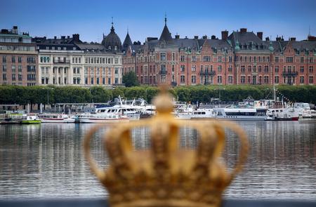 sightseeng: STOCKHOLM, SWEDEN - AUGUST 20, 2016: Skeppsholmsbron (Skeppsholm Bridge) with Golden Crown on a bridge and view on Ostermalm with sightseeng boats in Stockholm, Sweden on August 20, 2016.