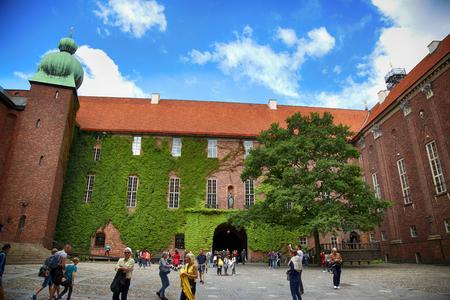 STOCKHOLM, SWEDEN - AUGUST 19, 2016: Tourists walk and visit Stockholm City Hall courtyard ( Stadshuset ), Ivy covered walls at City Hall in Stockholm, Sweden on August 19, 2016. Editorial