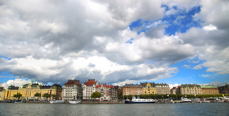 distric: View on Strandvagen street on Ostermalm distric with touristic sightseeing boats in Stockholm, Sweden Stock Photo