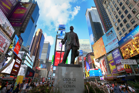 New York, USA – August 24, 2018: Statue of songwriter and performer George Cohan and many people on Times Square at 7th Avenue and Broadway in Midtown Manhattan, New York, USA.
