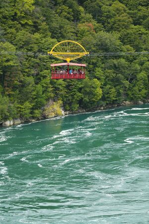 Niagara Falls, USA – August 29, 2018: Aero Cable car suspended on a sturdy cable with the view of the Niagara Whirlpool wild rivers from New York State, USA