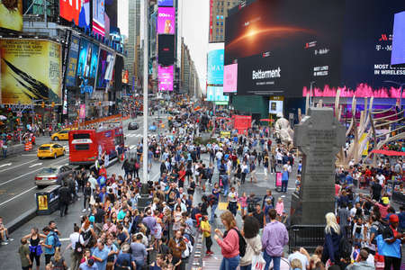 New York, USA – August 24, 2018: Crowded with many people walking Times Square with huge number of LED signs, is a symbol of New York City in Manhattan, New York, USA Editorial
