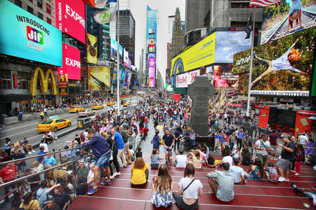 New York, USA – August 24, 2018: Crowded with many people walking Times Square with huge number of LED signs, is a symbol of New York City in Manhattan, New York, USA