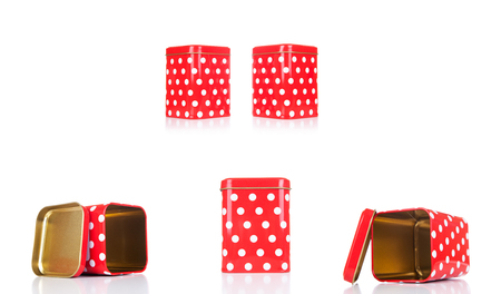 Empry Red metalic box with white dots and cover isolated on white background.Vintage tin box red with white dots.