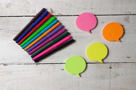 sticky notes with colored markers on wooden background top-view. Stock Photo