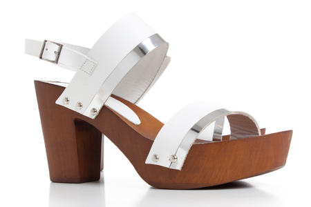 Woman white Leather Sandals,Womens Neutral Suede Wedge Sandals Isolated on White, get ready for your summer. Stock Photo