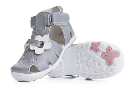 Gray shoes for kids isolated over a white background.