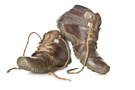 Old and dirty military boots isolated on white background. Stock Photo