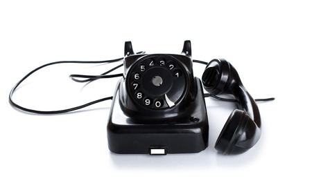 Black, old or classic telephone, isolated on a white background.