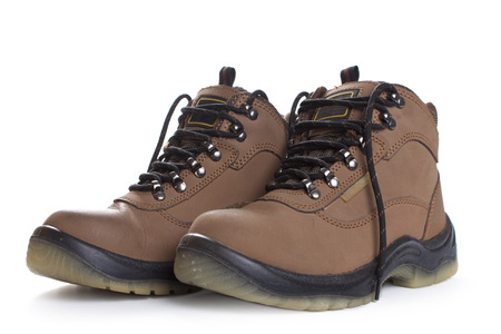 New brown working boots. Isolated on a white background. Stock Photo