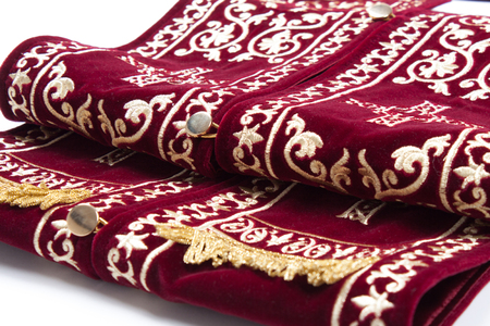 Maroon priest stole used for confessions on white.