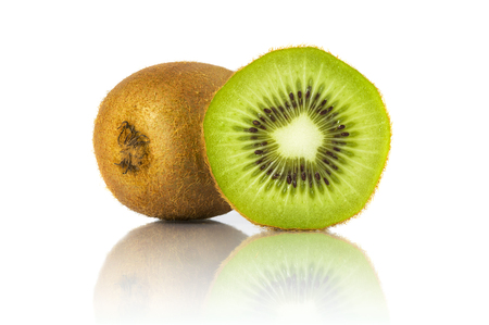 focus stacking: Whole kiwi fruit and a half placed next to it isolated on white background. All in focus using focus stacking technique