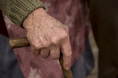 gerontology: Elderly woman holding stick
