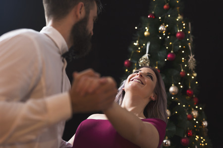 Beautiful, young couple in love hugging and dancing a midnight waltz