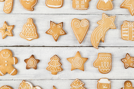 stock photo top view of different shapes of nicely decorated christmas cookies on wooden background