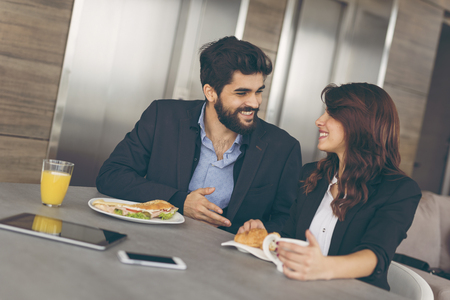 Two colleagues having breakfast in companys restaurant Stock Photo