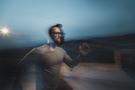 Blured motion, long exposure image of an athletic man jogging Imagens