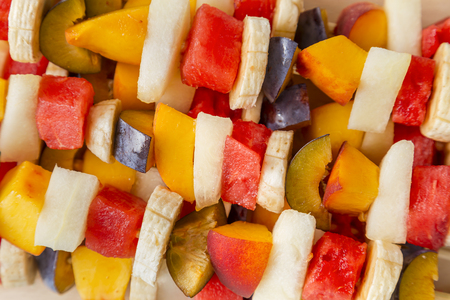 Colorful mixed fruit salad served on barbecue sticks Stock fotó