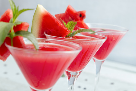 Cold watermelon cocktails served in martini glasses as a summertime refreshment