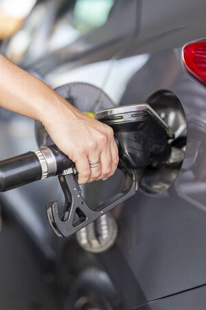 Car refueling at a petrol station; car tank refilling at a gas station Stock Photo
