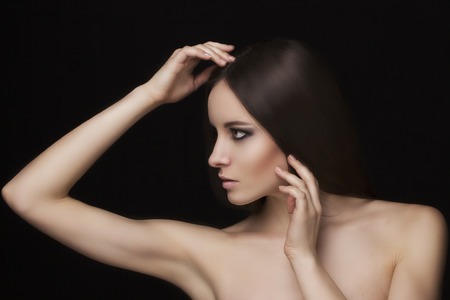 beauty shop: Beauty natural face model with smoky eyes makeup and hair style Stock Photo