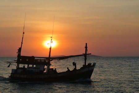 Fishing boat in sun Stock Photo
