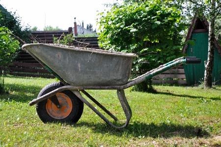 Garden wheelbarrow in the village