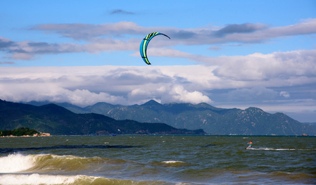 Kite surfer ride waves in summer day