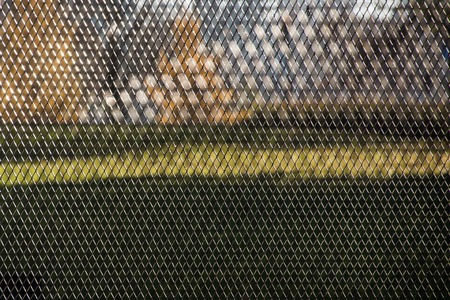Steel wire mesh fence abstract rhythmic background texture for design