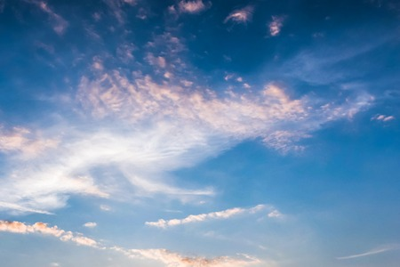 White spindrift clouds on blue sky Stock Photo